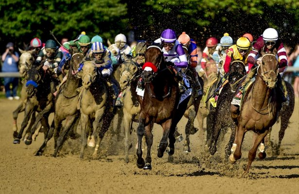 LOUISVILLE, KY - MAY 07: Nyquist #13 (purple cap), ridden by Mario Gutierrez, forges to the front en route to winning the Kentucky Derby on May 7, 2016 in Louisville, Kentucky. (Photo by Daniel Owen/Eclipse Sportswire/Getty Images)